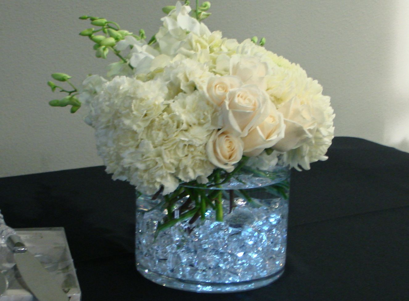 Seasonal whites led lights gems centerpiece flowers